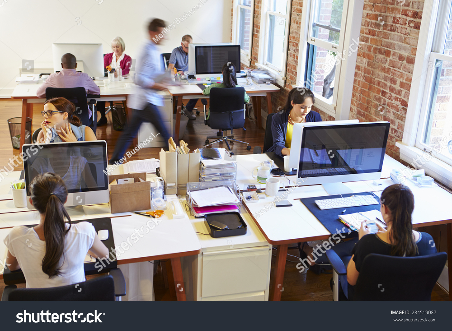 stock-photo-wide-angle-view-of-busy-design-office-with-workers-at-desks-284519087